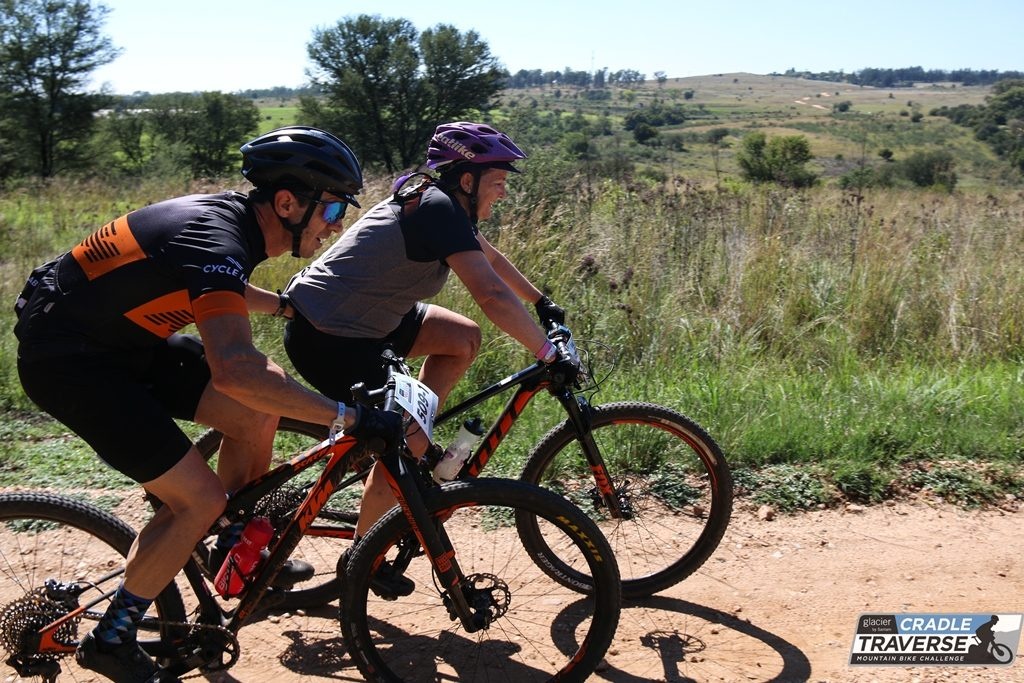 Sean Bardenhorst gives his wife Joanne a helping hand during Stage 2 of the Glaicer Cradle Traverse. The Bardenhorsts are one of many mixed teams in the race. Photo by Sage Lee Voges for www.zcmc.co.za