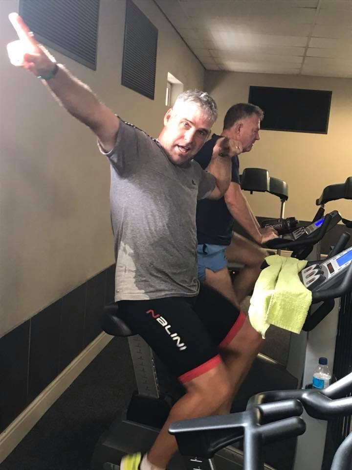 On the indoor bike getting ready for his cycling challenge with Michael V